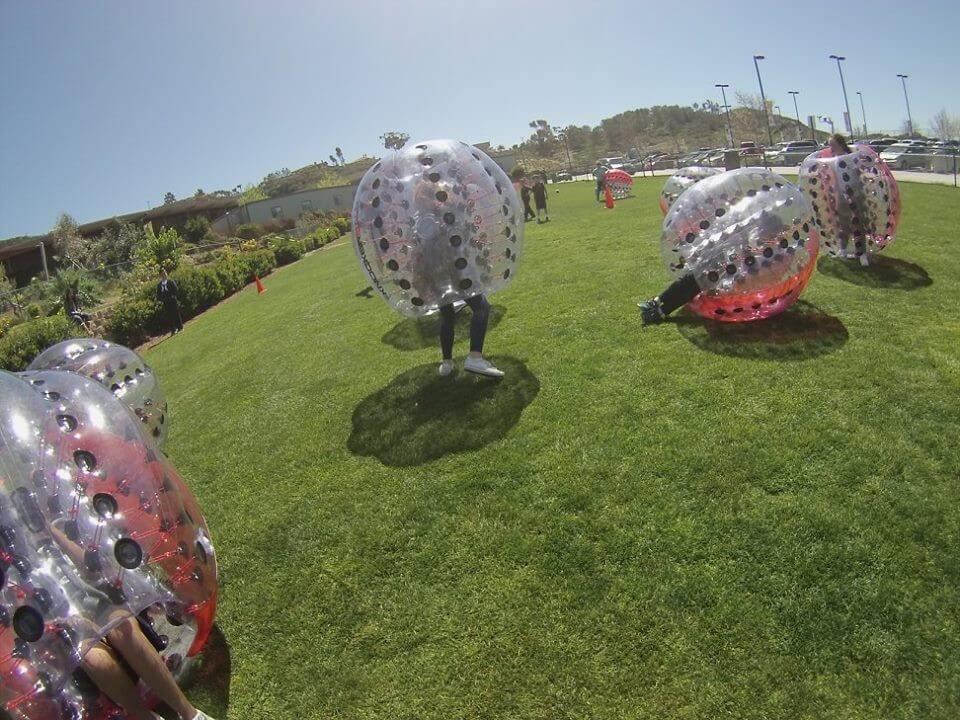 Kids in plastic balls